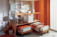 Awesome Contemporary Boys Bedrooms Design Ideas By Mariani : Inspiring Comfortable And Highly Functional Orange Color Contemporary Boys Bedroom Design With On Wheel Beds Upper Desk Chair Bookshelf Rug Porcelain Tile Flooring Ideas