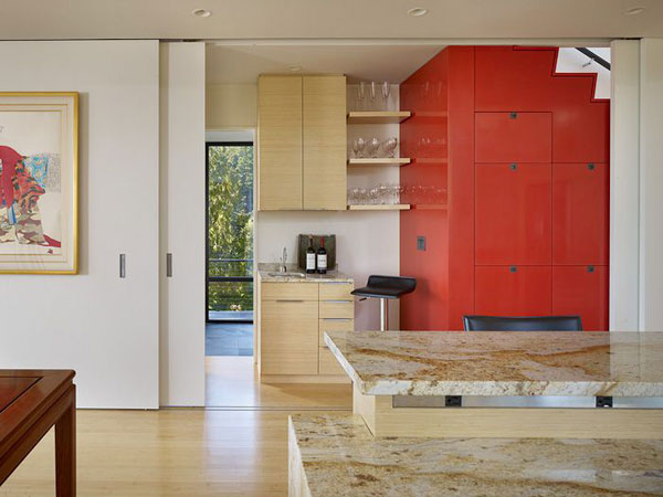 Chuckanut Ridge House: An Elegant Design Asian Influences And Self Sustainable Housing: Inspiring Large Sliding Divider Room Between Modern Kitchen And Mini Bar Design With Red Color Storage Inside Stairs Marble Countertop Barstool And Wooden Flooring Ideas