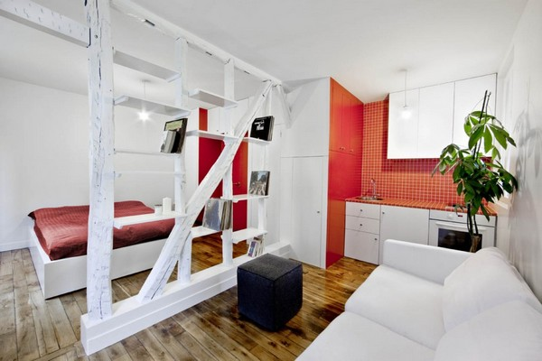 Small Apartment Design And Decoration : Inspiring Red White Small Apartment Wood Flooring Simply White Bed White Sofa Wooden Beams Bookcase Room Dividers Redwhite Closets Simply Kitchen Island Hanging Closets