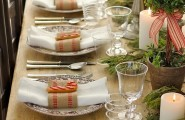 Traditional Collection Vintage Christmas idea : Inspiring Rustic Christmas Table Setting Simple White Candles Small Potted Tree Plants With Striped Red Ribbons Clean Simple Rough Wooden Dinner Table