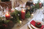 Festive Christmas Decorations For An Adult : Inspiring Rustic Christmas Table Setting With Long Square Wooden Pot Wit Pine Leaves Red Berries And Big Red Candles Center Piece Checkered Napkin Accent