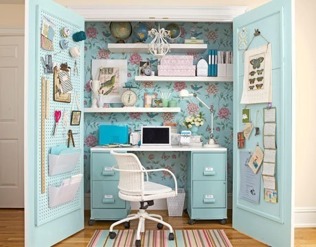 Cute home office ideas: Inspiring Secret Compact Home Office In A Closet With Blue Flower Decorated Wall Use Small Desk Alongside Small Boxes