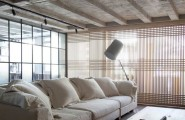 Extravagant Sleek Interior Design For A Loft : Inspiring Untreated Ceiling With Outstanding Laminated Wooden Floor Design And White Cozy Sofa White Cushions Arch Lamp