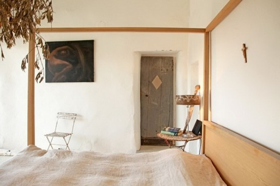 Unique Stone House: Interesting Unique Home With A Simple Bedroom With Wooden Sticks And Thin Sheets And Tea Table With Clean White Walls And Stunning Paintings ~ stevenwardhair.com Architecture Inspiration