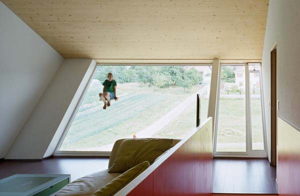 CROOKED HOUSE: Self Sustainable House In Swiss Countryside: Interior Design Crooked House With Natural Light By Installing Huge Windows