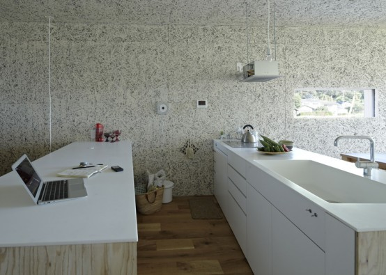 Remarkable Natural Home Design for Your Dream Getaway : Laptop White Washbasin Faucet Wooden Floor Artistic Wallpaper