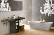 Remarkable Contemporary Bathrooms Design From Neutra : Large Mirror Plays The Perfect Balancing Act Between The Natural Stone Wall And The Over Sized Chandelier In This Cozy Elegant Bathroom Remarkable Contemporary Bathrooms From Neutra