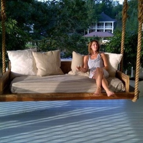 Calm Relaxing Outdoor Hanging Beds For You: Large Relaxing Outdoor Wooden Hanging Bed With Sturdy Thick Ropes And Thick Soft Beddings And Big Plain Pillow Cushions