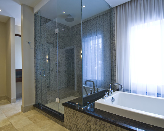 Whirlpool, Bathtub and Shower Combination: Lavish Luxury Shower And Tub Skirt Shower Connected To Bathtub As Bench With Full Mosaic Tile On Side Of Tub Matching Shower