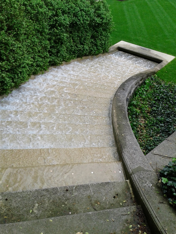 Stunning Relaxing Garden And Backyard Waterfalls : Marvelous Simple And Stylist Stone Curve Staircase And Nice Style Water Fall Over Looking A Perfect Well Kept Green Lawn And Tall Shrubs