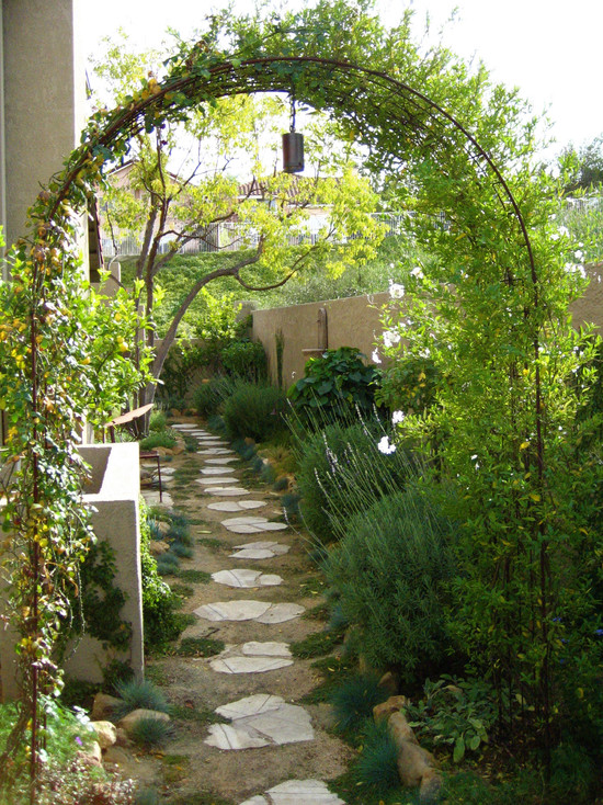 Back Yard Make Overs : Mediterranean Landscape Garden Make Over With Small Rock On The Ground The Arch And The Stone Path