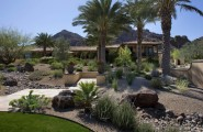 Fascinating River Rock Landscaping Pictures : Mediterranean Landscape Gardens Mulched With Rock Seem To Be In Full Sun And Shady Area
