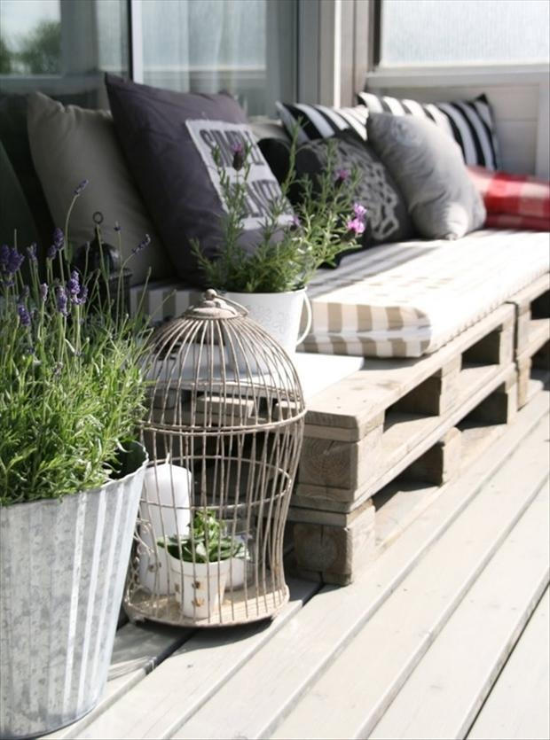 Motivational Pictures To Inspire You To Design Your Home Deck : Mesmerizing Outdoor Decking Line Idea With Chic Rustic Design Lavender Plants In Pots And Wire Birdcage Accessories With Black And White Cushion Bench