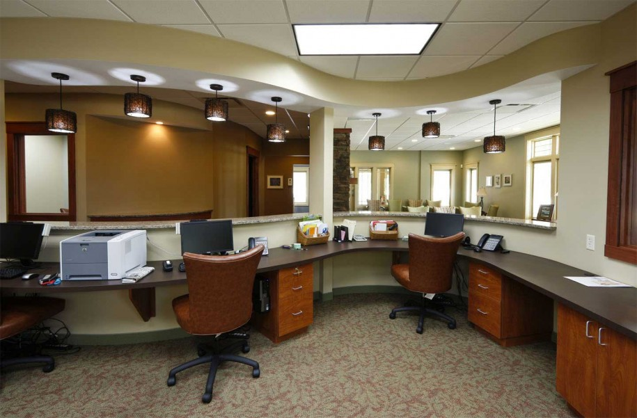 Beautiful Office Interior Designs in Modern Concept: Minimalist Chandeliers Brown Swivel CHairs Classic Motives Carpet Hidden Lamps