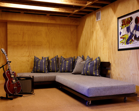 Functional Fold Up Couch Bed Designs : Modern Basement With A Classic Guiter And 2 Purple Single Beds To Make A Double As A Bed And Sitting Area Rolling Away Beds
