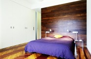 Modern Furniture Decoration for Contemporary Apartment : Modern Furniture Decoration For Contemporary Apartment With Blue Bedcover Two Purple Large Pillows Yellow Small Pillow Laminate Wall White Wardrobe
