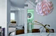 Captivating Apartment Interior That Will Satisfy Your Need : Modern Futuristic Apartment With Clean White Pallette Round Accent Pendant Lamp Bathroom Mirror Vase Carpet Dining Table