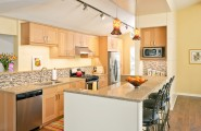 Wonderful Light Maple Kitchen Cabinets For Your Home Designs : Modern Kitchen With Custom Blown Pendant Lights Beautiful Texture And Color Patterned Backsplash And Countertops That Break Up The Cabinet Light Maple Zen Sink Stove On Same Bank Of Cabinets