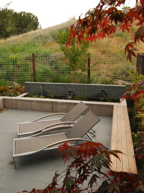 Marvellous Wood Slab Benches: Modern Landscape Cedar Bench Extends Perpendicular Out From The Water Feature On The Outside Of The Slate Patio Maximizing Seating Space In The Limited Size Garden
