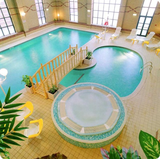 Various Indoor Swimming Pool Design Ideas: Most Beautiful Indoor Swimming Pool With Romantic Bridge And Cool Jacuzzi Design