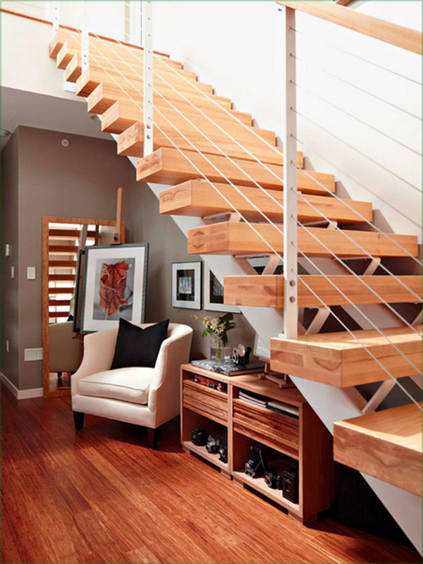 Inspiring Storage Design Under Staircase: Natural Interesting Nice Laminated Wooden Stair Steps Design White Armchair Under Stair Storage
