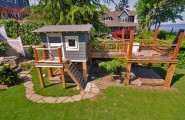Design Your Own Garden Playhouses For Children : Playhouse On Side Yard Beach Style Landscape Sandbox Climbing Plyhouse Deck Removable Grates On Top Of The Box