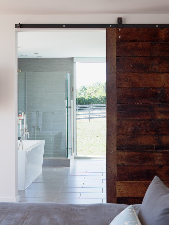 Building The Sliding Barn Door : Proch House Modern Bathroom With Slat Sliding Barn Door Separates The Bedroom And Bathroom