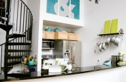 A Properly Designed Small Kitchen With Minimal Cutter And Maximum Efficiency : Really White A Properly Designed Small Kitchen With Minimal Clutter And Maximum Efficiency Built In Kitchen Next To The Starecase With Storage