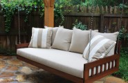 Calm Relaxing Outdoor Hanging Beds For You : Relaxing Beautiful Simple Outdoor Hanging Bed Made Of Sturdy Wood And Soft Bedding And Large Pillow Cushions