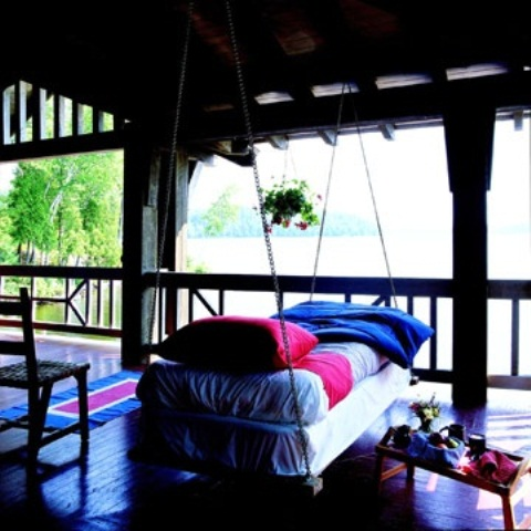 Calm Relaxing Outdoor Hanging Beds For You : Relaxing Traditional Tropical Outdoor Hanging Bed With Simple Bedding And Bright Pillow And Blanket On A Porch Overlooking The Beach