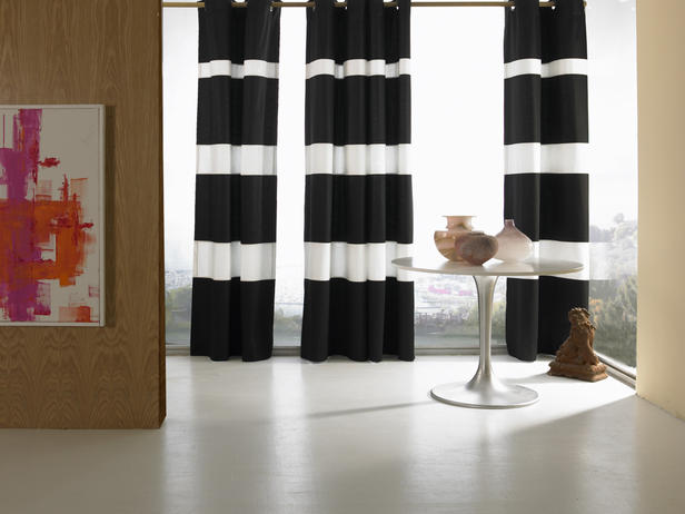 All Kind Of Stylish Drapery Treatments Design: Rings Inserted Into The Top Of The Black And White Stripe Curtain Fabric Large Glass Window Design With Vases On Round Table With Picture Hang On Wooden Wall Ideas