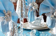 Gorgeous Holiday Table Arrangements : Shiny Silver Cones And Blue Ornaments With Folding A Cloth Napkin With Holiday Florists Pick In A Wine Glass Cool Holiday Table Arrangements Awe Inspiring Table