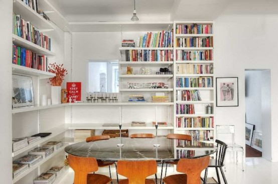 Original Scandinavian Apartment's Interior With Play Of Materials And Colors : Simple Apartment Decoration With Round Glossy Top Dining Table With Contemporer Wooden Chairs And Organized Book Shelves On White Pallette Tiny Pendent