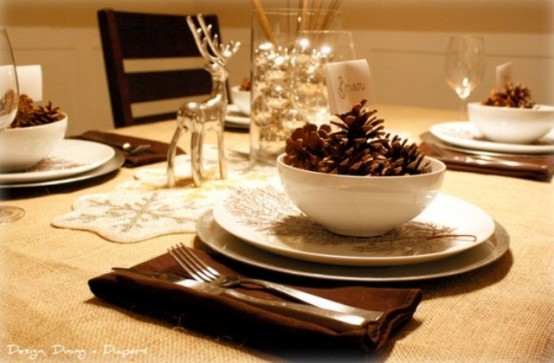 Traditional Collection Vintage Christmas idea: Simple Elegant Christmas Table Setting Pine Cones In White Dinner Wares Silver Deer Statue And Small Shiny Balls In A Clear Jar As Center Piece Warm Glow