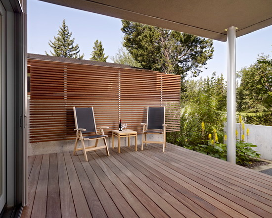 Amazing Simple Minimalist Wood Slats For Walls : Simplicity Small Deck Modern Porch Outdoor Spaces Covered By Slatted Wood Wall Provides A Backdrop With A Partition Added To An Already There Concrete Wall