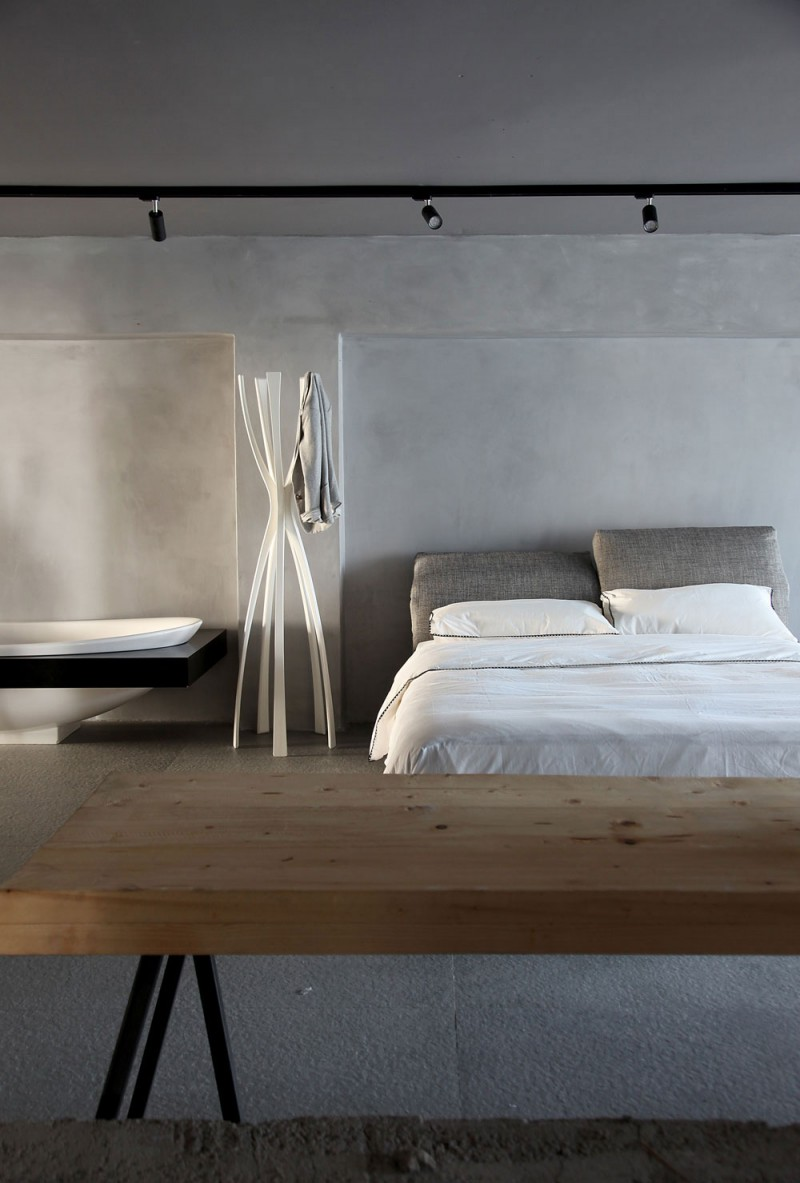 Extravagant Sleek Interior Design For A Loft : Sleek White Bedsheet White Blanket 2 White Pillows With Outstanding Concentrate Floor Design And Soptlight Wooden Table