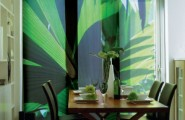5 Sliding Panel Window Treatments That Acts as Room Dividers Too : Sliding Fabric Panels With Stylish Green Cover Casual Dining With Unique Wooden Dining Table And Chairs Beside Interior Rack Mounted In The Wall