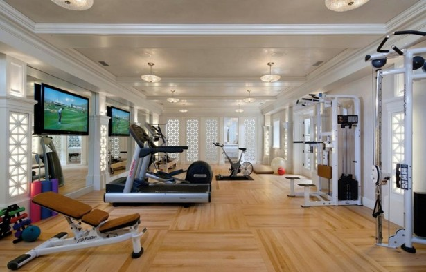 Inspiring Strategically Placed Gym In A Stylist Living Room: Spacious Gym Area With Complete Modern Tools And Large Flat Screen Tv With White Carving Windows And Doors ~ stevenwardhair.com Cabinets Inspiration