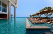 Spectacular Infinity Pool 2 : Spectacular Infinity Pool Design With Pool Lounge On Water Umbrellas Ideas