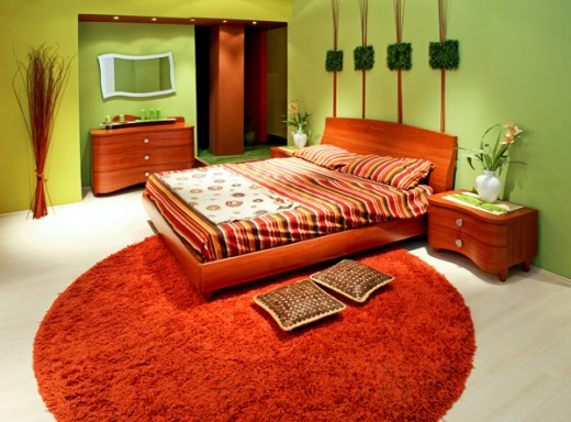 Small Master Bedroom Colors Design Ideas: Stuning Orange Color Small Master Bedroom Design With Round Rug Wooden Flooring Lighting Ideas