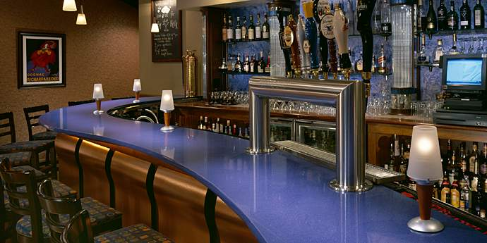 Dupont's Best Value Countertops Design: Stunning Bar Design With Celestial Blue Dupont Bartop And Barstool Bottle Shelves Glass Lamps Wall Decor Wallpaper Ideas