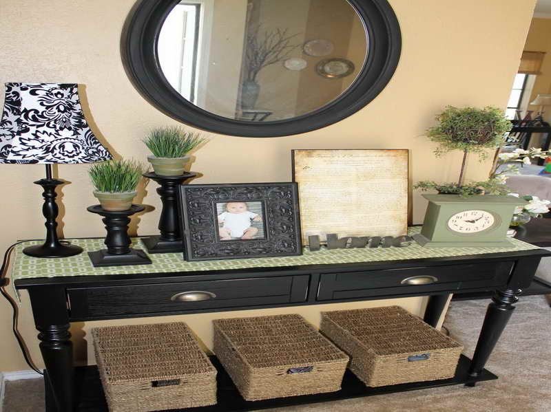 Inspiring Entryway Furniture Design Ideas: Stunning Common Design Black Wooden Entryway Tables And Black Oval Wooden Frame Mirror And Rattan Storages