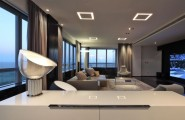 Sleek Apartment With Smart Look And Upstanding Approach : Stunning Hidden Lamps TV Sofa Fur Rug Large Glasses Window With Remarkable Marble Floor Design And Nice Fur Rug With Great Windows And Nice View