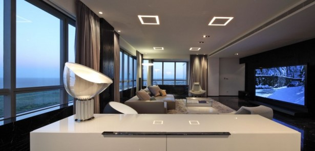 Sleek Apartment With Smart Look And Upstanding Approach: Stunning Hidden Lamps TV Sofa Fur Rug Large Glasses Window With Remarkable Marble Floor Design And Nice Fur Rug With Great Windows And Nice View ~ stevenwardhair.com Apartments Inspiration