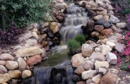 Great Falling Water To Create A Real Harmony Life : Stunning Man Made Stream Using Cream Colored Rocks And Boulders With Beautiful Adorning Lavender And Green Plants