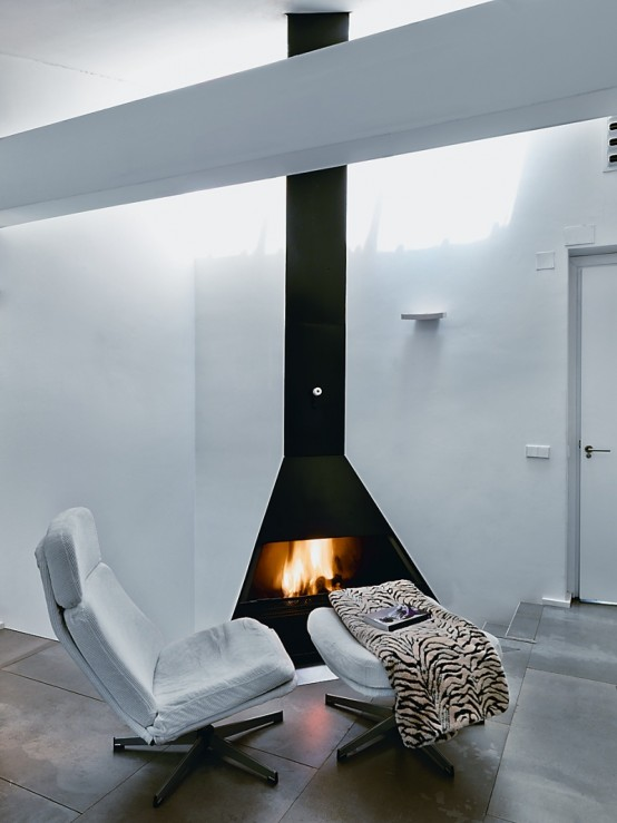Captivating Apartment Interior That Will Satisfy Your Need: Stylist Modern Fireplace With Simple White Reclining Chair And Soft Tiger Blanket As Accent Special Warm Nook To Unwind