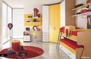 Amazing Trendy Bold Color Comfy Kids Room : Sunny Bright Trendy Red Yellow White Kids Bedroom With Boxing Themed And Bunk Beds For Spacious Room With Large Round Red Carpet As Accent Marble Floor Design