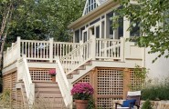 Adding Lattice to The Deck Home : Sunroom And Deck Traditional Porch With Hidden Storage Behind Lattice With Crossbeam Under Decking With White Railings