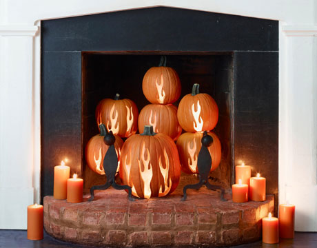 Halloween Mantel Decorating Ideas for Spooky Party: Surprising Halloween Mantel Decorating Ideas Fire Carvings On Pumpkins Inside A Fireplace Orange Candles Unique Decorations