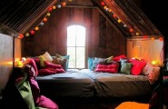 Healthy Home : Surprising Healthy Home Bedroom Colorful Cushions Rug Wooden Floor Exposed Sloping Ceiling Attic